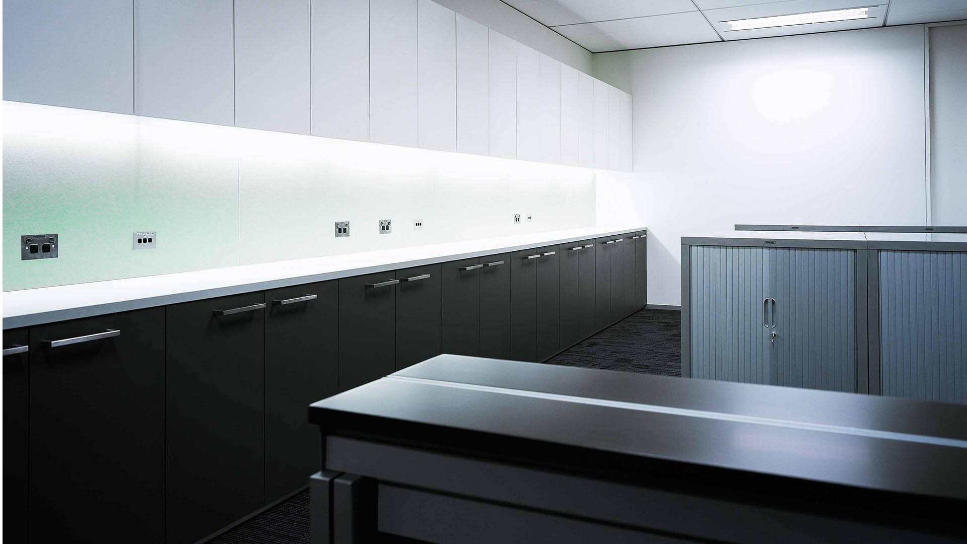 Quadrant Utilities Area by Dobsonei with cupboards and power outlets.