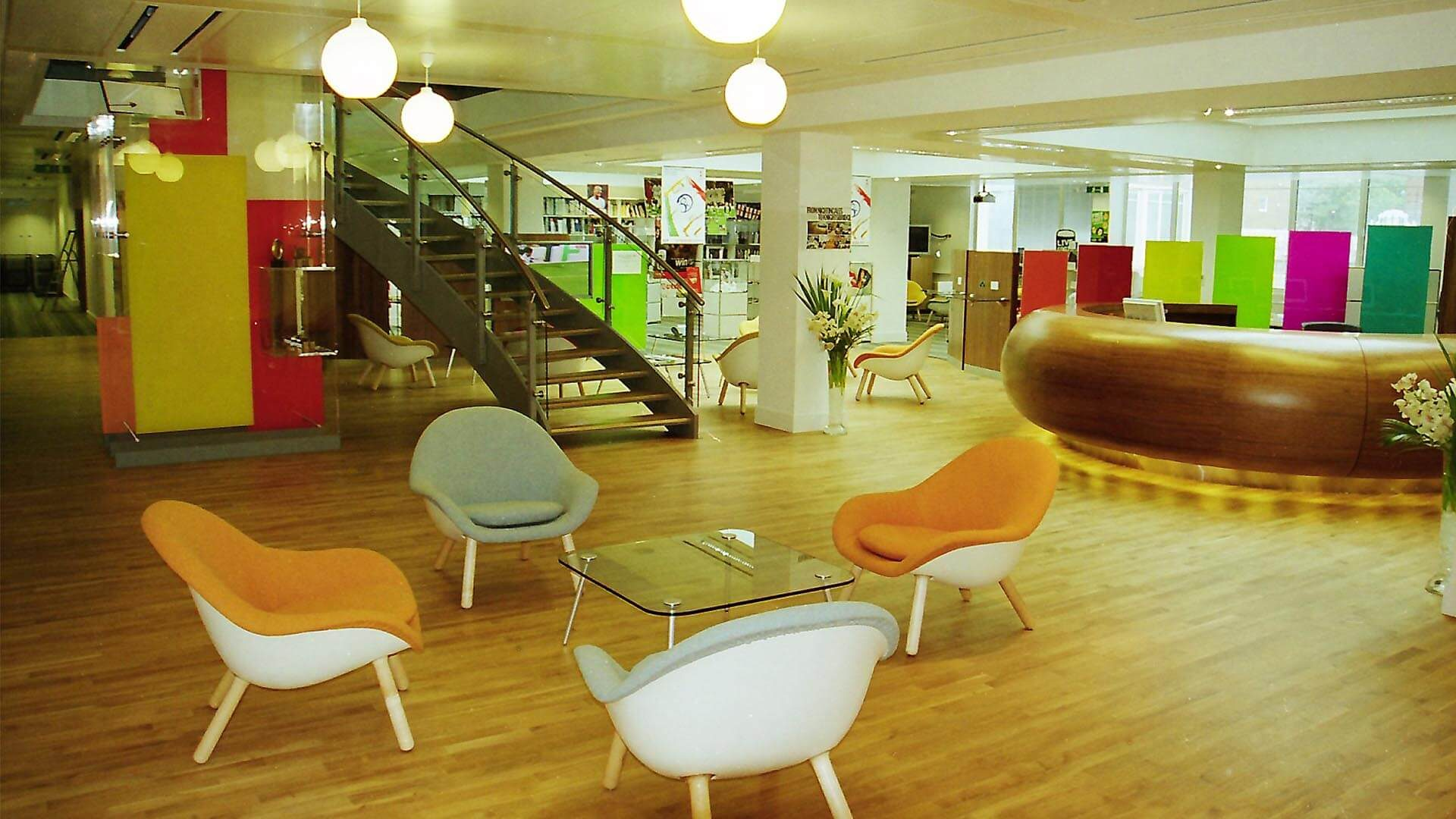 J Walter Thompson Award Winning interior with tables and chairs and interior staircase