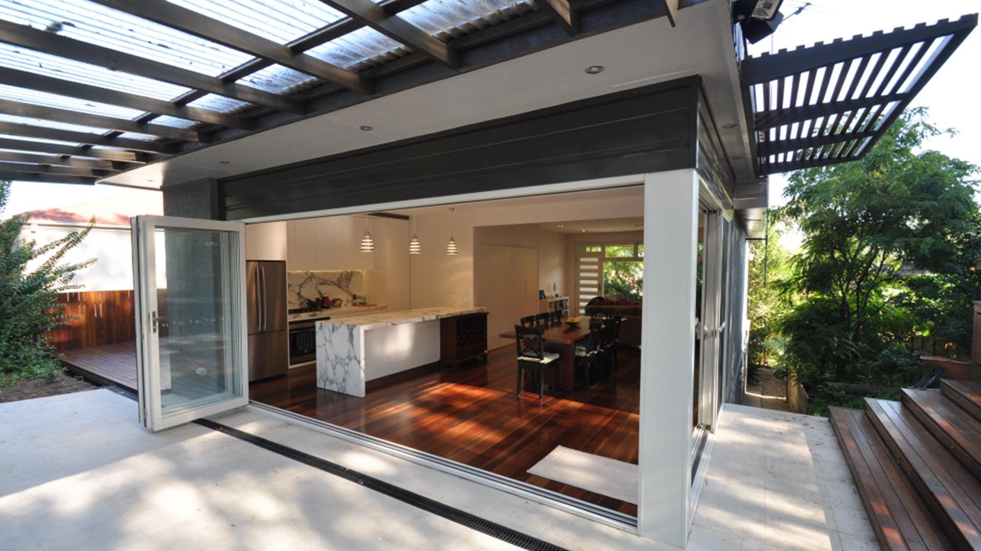 Ganora Rear entertaining area with bifold doors leading into living room and kitchen