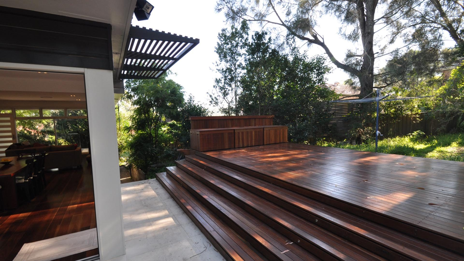 Ganora Outside tiered deck leading into yard with clothesline and grass