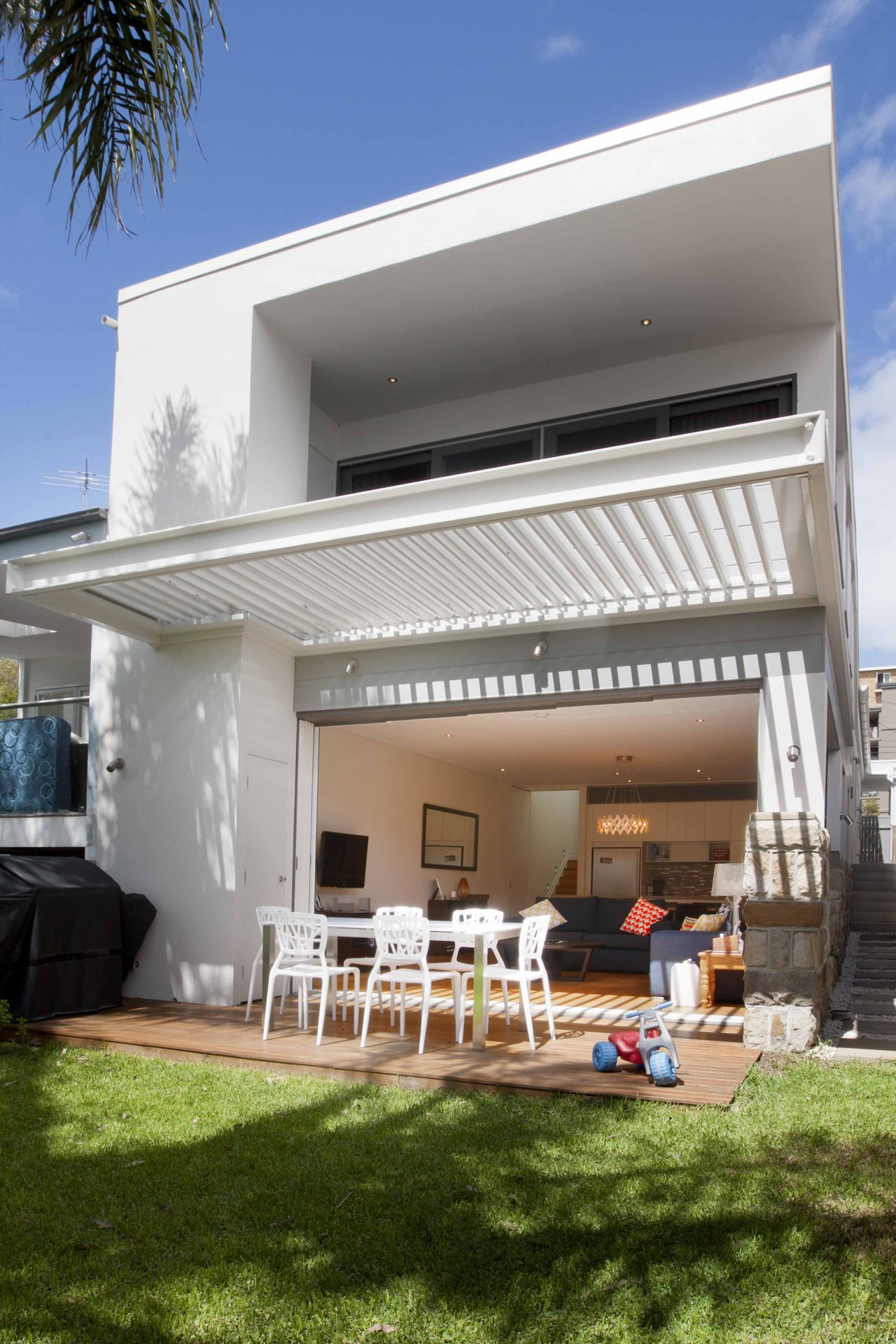 Clovelly Backyard with outdoor entertaining area leading into living room